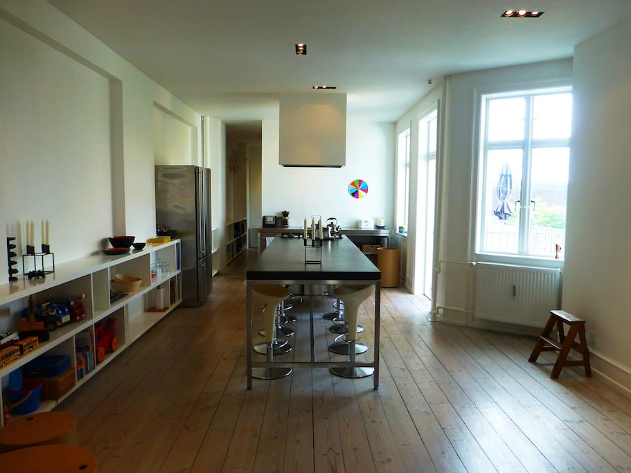 Open kitchen/living room with direct access to balcony