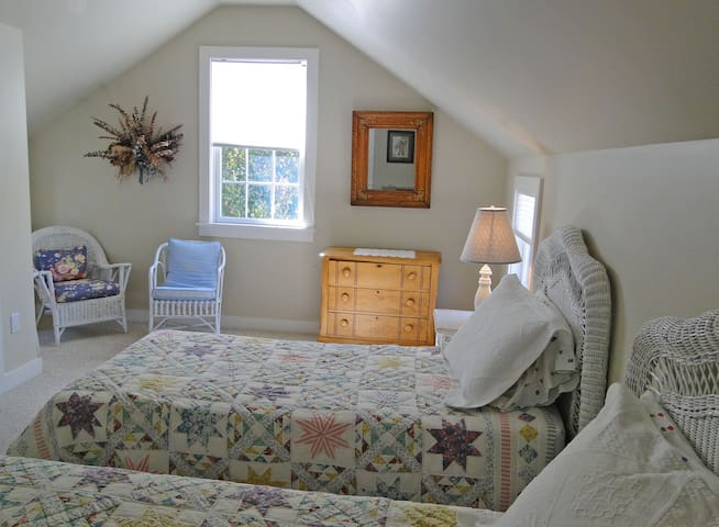 Roomy upstairs bedroom with 2 twins. Air conditioned. Large closet, plenty of hangars.