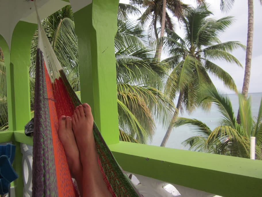 Relax in a hammock while listening to the sounds of the sea.