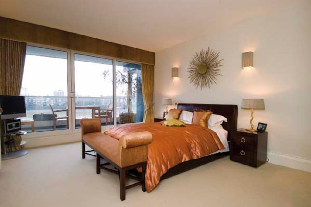 Master bedroom with river views, private balcony and ensuite