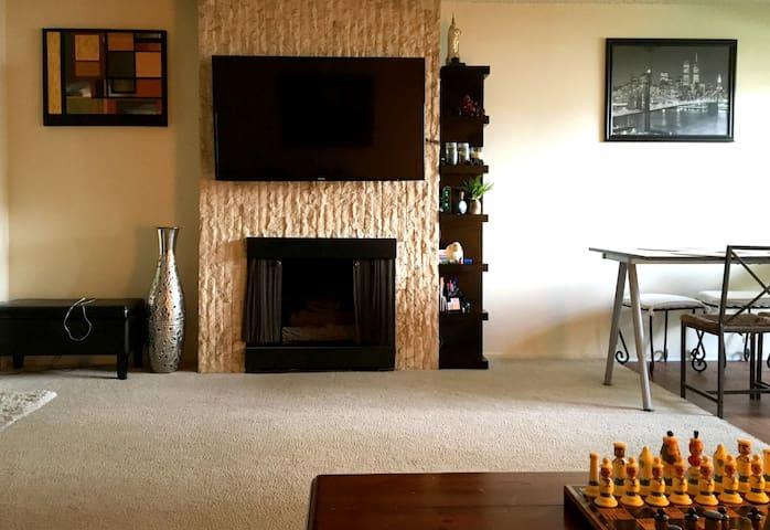 Living room. Fireplace. Samsung 55'' HDTV with AppleTV
