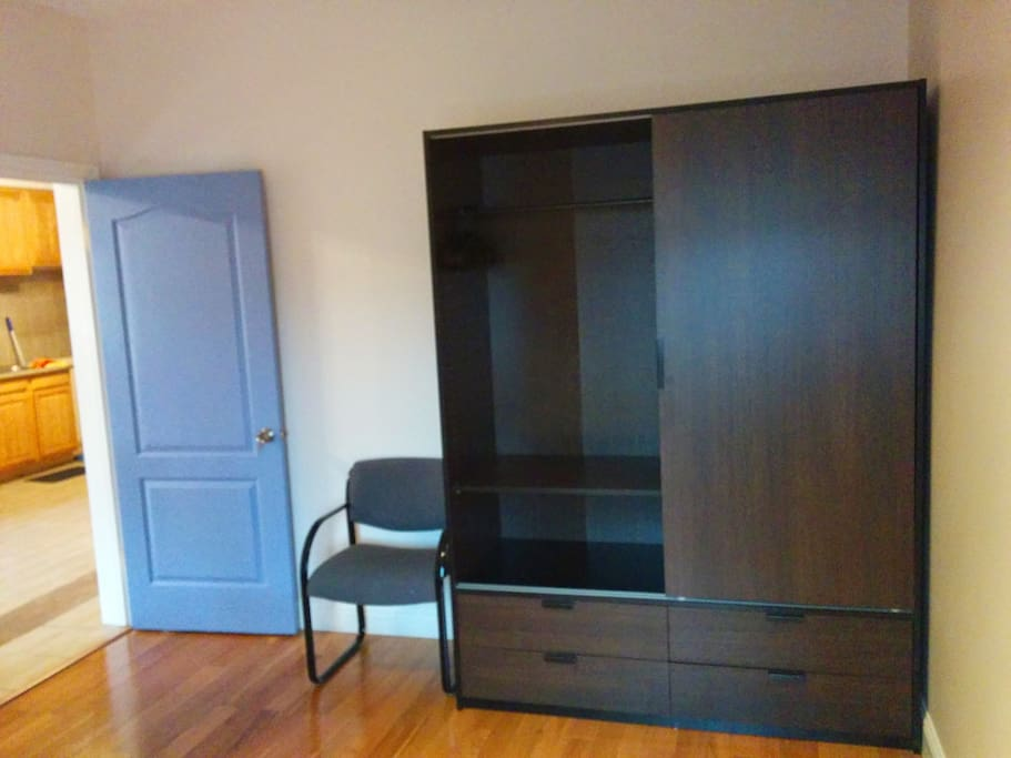 Very large closet to hang clothes or store in drawers