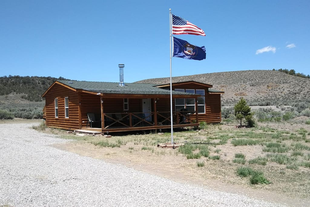 Front of house with Utah State and U.S. flags