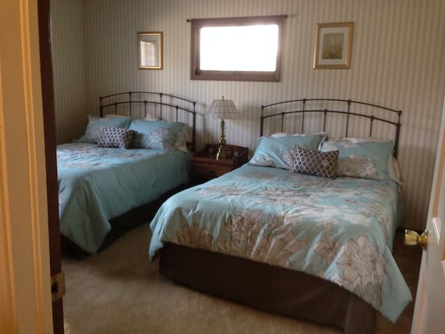 2nd bedroom with two full size beds