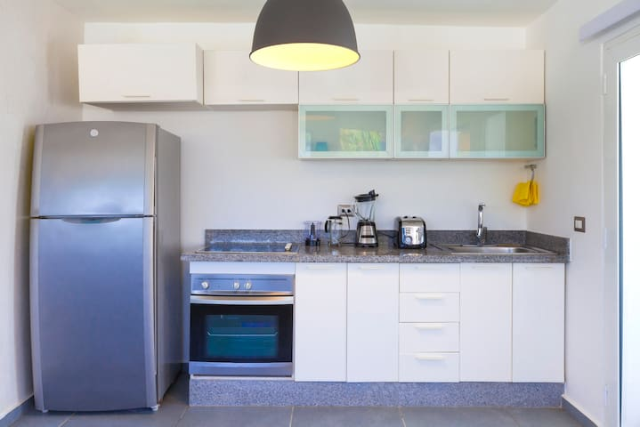 All you need,  for your comfortable staying in the apartment. The kitchen is fully-equipped with oven, fridge, coffee maker, toaster, blender, you will find other tableware in the cupboards.