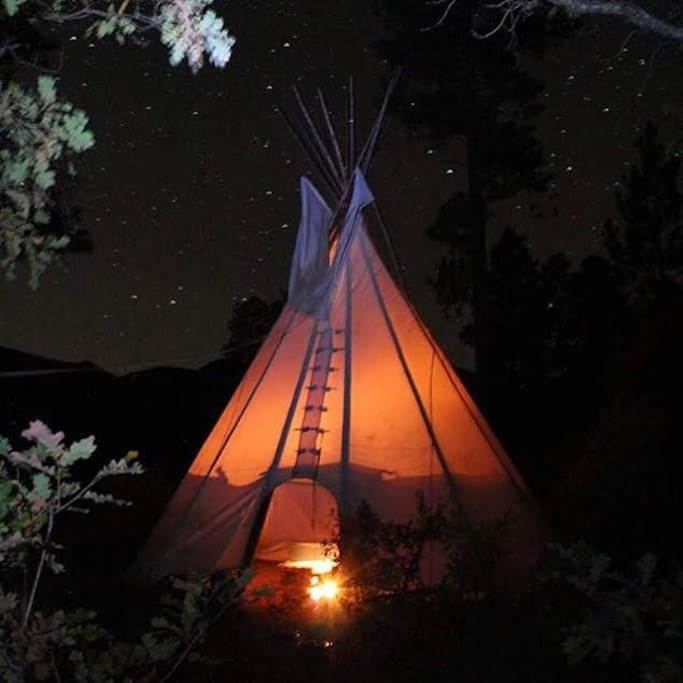With a fire burning the tipi has a nostalgic feeling on a summer night