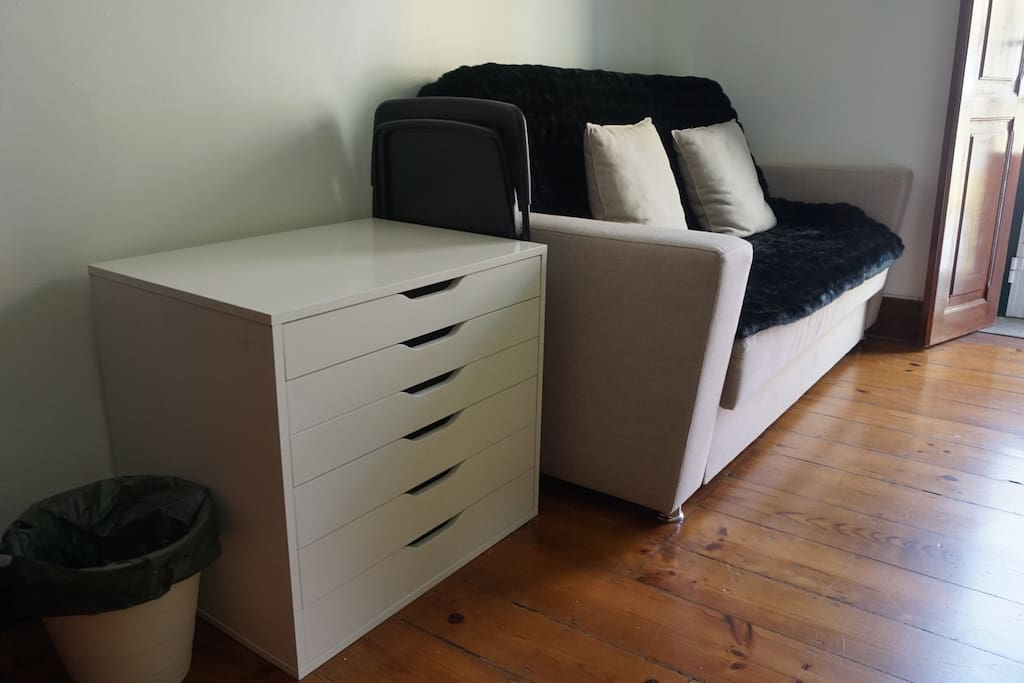Comfortable couch and chest of drawers