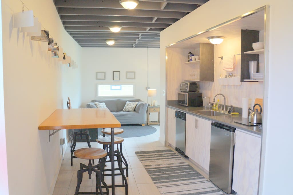The galley kitchen was custom built by the local design firm TAKD, and has everything for a short term stay.