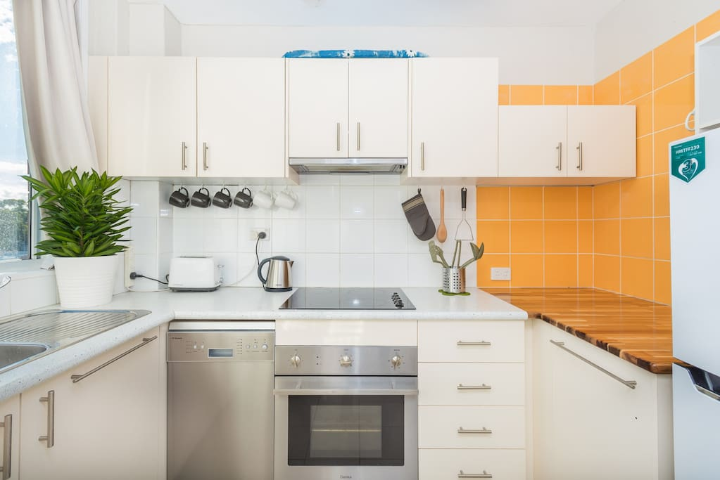 The kitchen is very modern with everything you need! Guests can use everything provided. An ironing board is provided at the top too.
