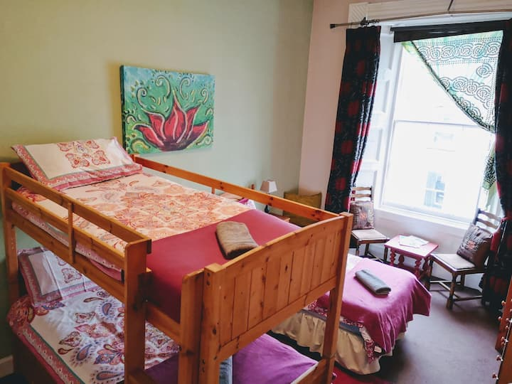 Single bed in 3-bed female dorm
