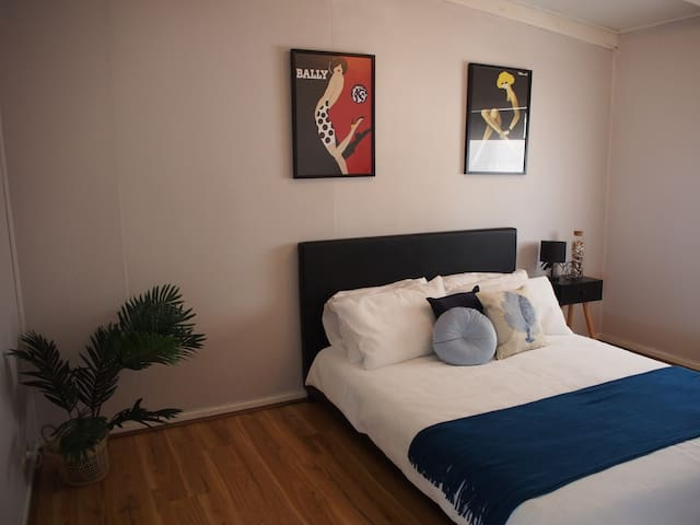 Main bedroom with queen bed and tv