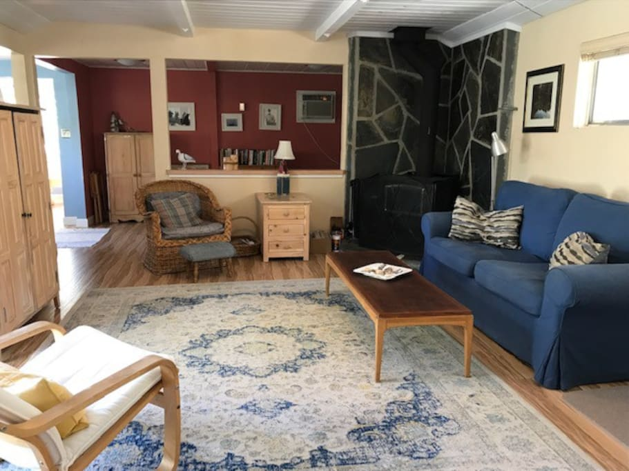 Cozy, comfortable living room area has wood stove