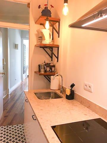 Kitchen - countertop is in authentic Pedra Lióz, a fossil-rich Portuguese stone