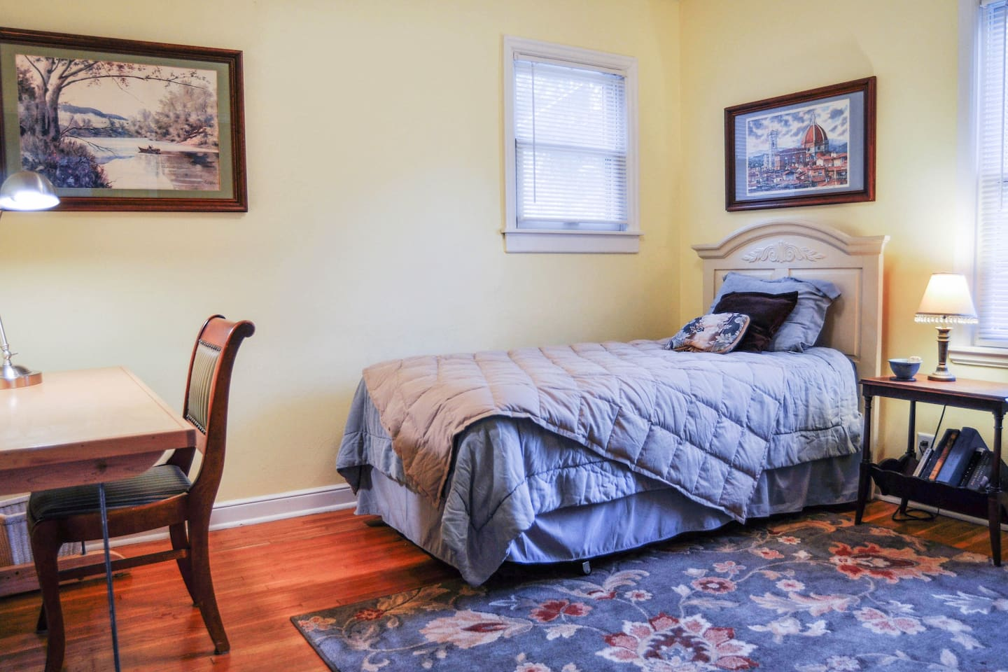 Quiet bedroom with  twin bed and work station.