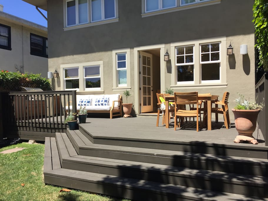 backyard: teak dining table seats 6. Kids' booster seats available.
