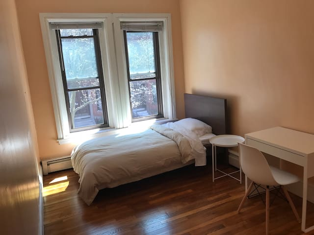 Private room in modern brownstone next to Longwood