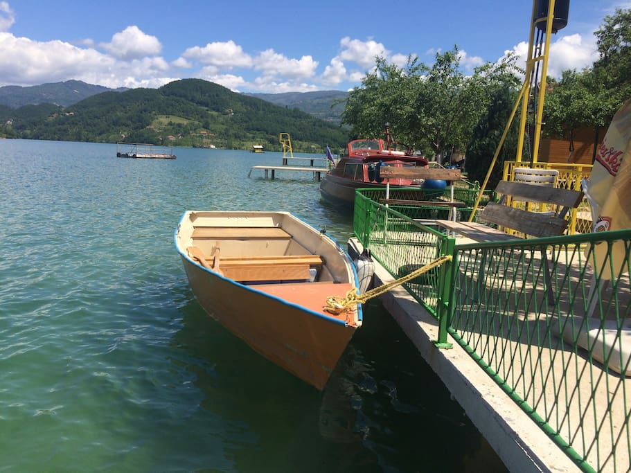 Area outside, old boat which can be used on the lake if available.