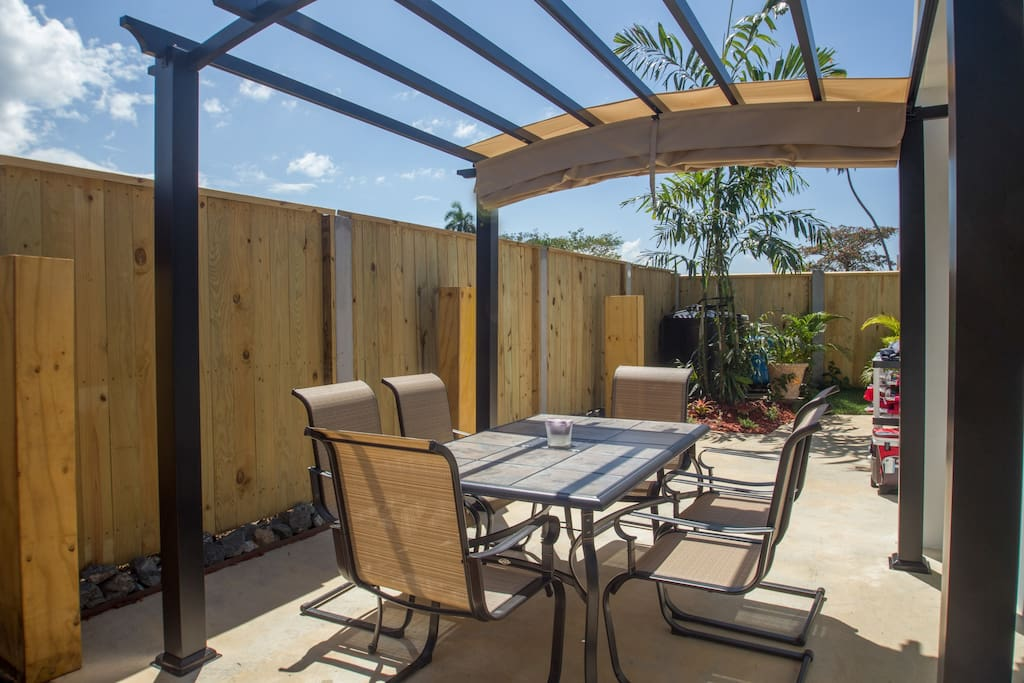 Private Back Patio- Table, chairs and pergola.