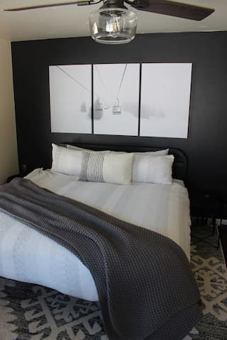 Main floor master includes king size bed, flat screen TV, sitting area, walk-in closet and 5-piece ensuite bath.