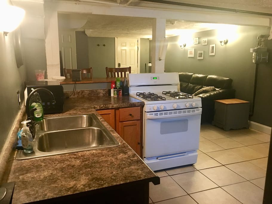 Full kitchen with stove, fridge, microwave, and whatever you need to prepare a meal