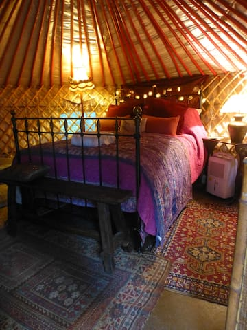 Quality cotton bedding is used on the yurts very comfortable bed.
