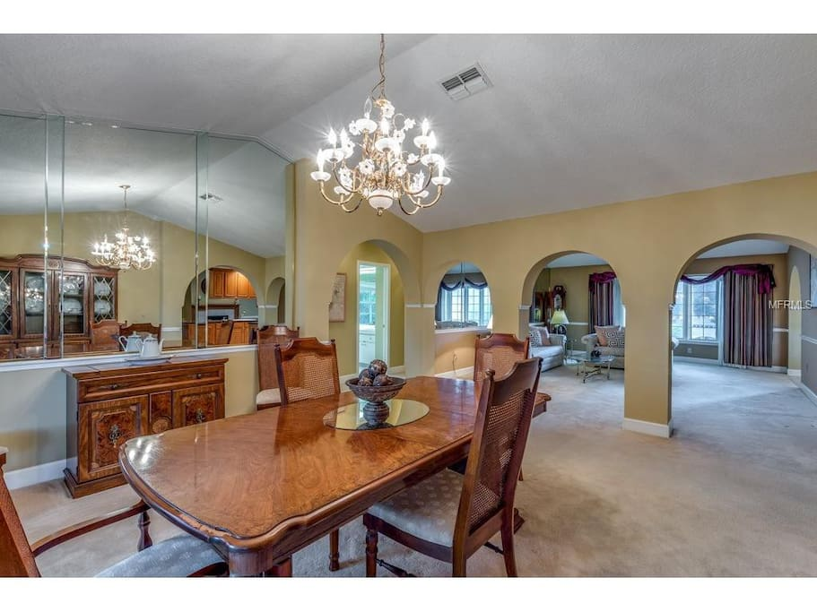 Huge living room accented w/ archways