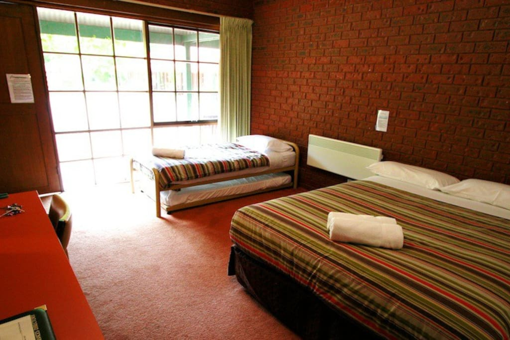 Our standard queen rooms have a queen bed, a single bed and a roll out single bed plus large ensuite bathroom.