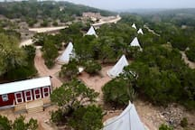 Aerial view of 7/10 tipis and the bathhouse