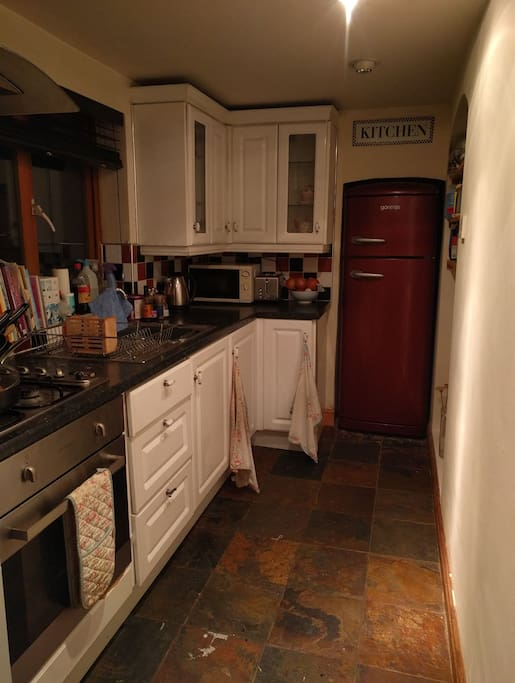 Kitchen which includes separate guest fridge
