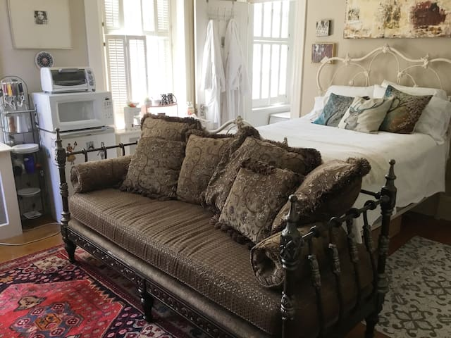 The daybed acts as a sofa during the day and can accommodate an extra person. Linens and pillows for the daybed are included.