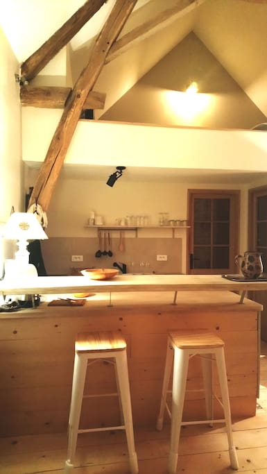 View of kitchen area and mezzanine