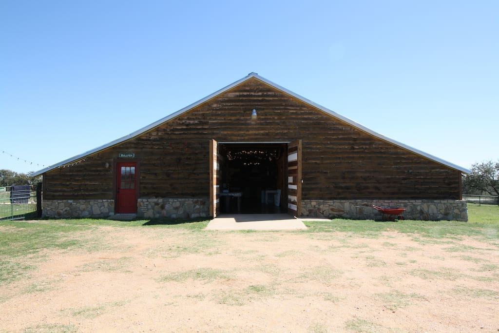 This is the refinished barn that works as an event center, wedding reception, or any other type of group gathering.  It has a dance floor, stage, bar and plenty of seating.  The door to the left is the entrance to the bunkroom/bullpen.