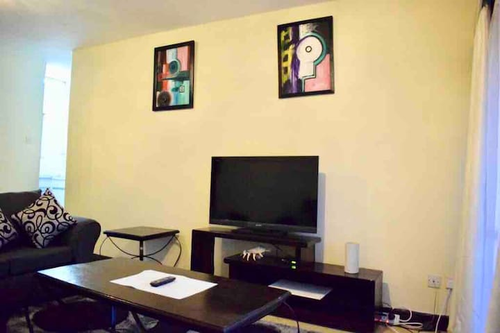 """Living room view with 42"""" TV, cable and internet"""