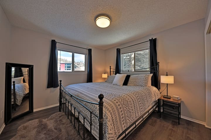 Master bedroom with king size bed and vanity.