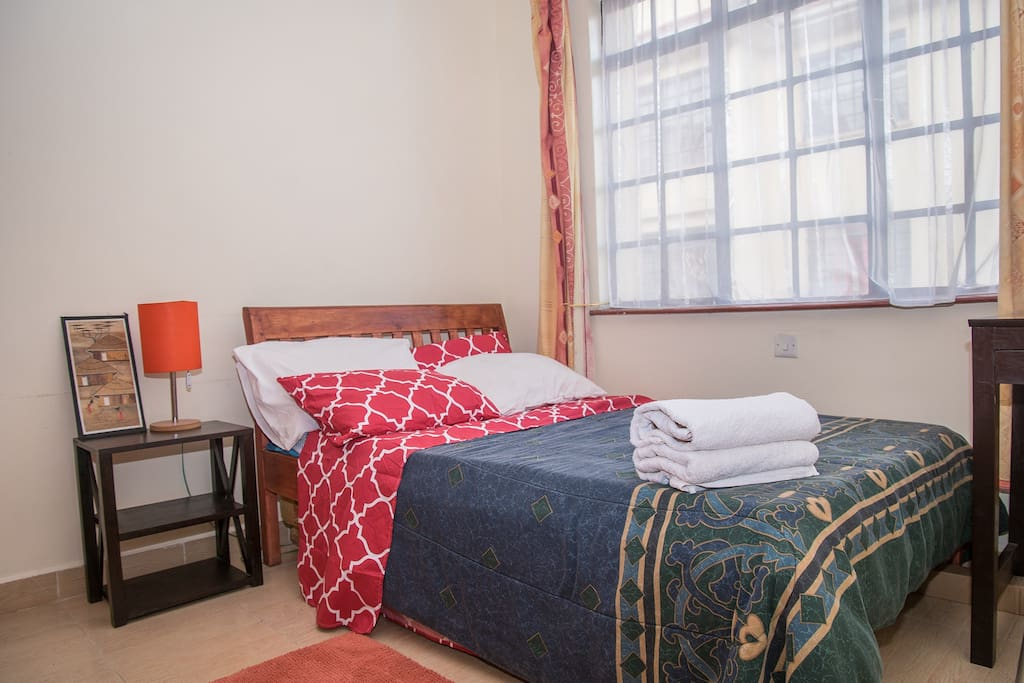 Spacious private room with a Queen  size bed,spacious wardrobes and high density mattress
