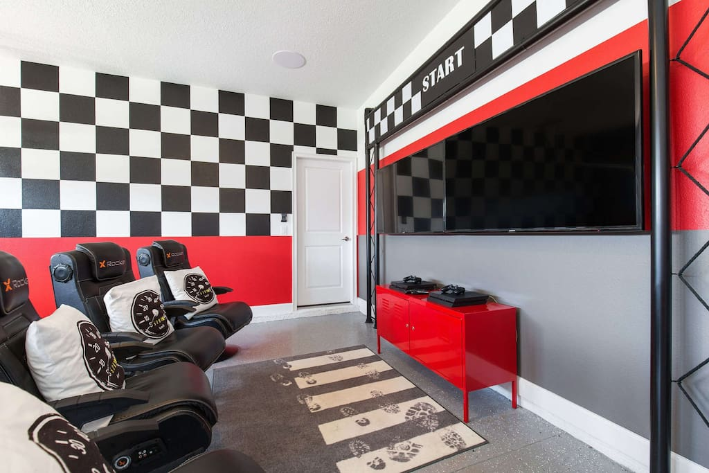 The gaming station features two mounted LCD HDTV's, 4 X Rocker Pro chairs, and 2 PlayStation 4's.