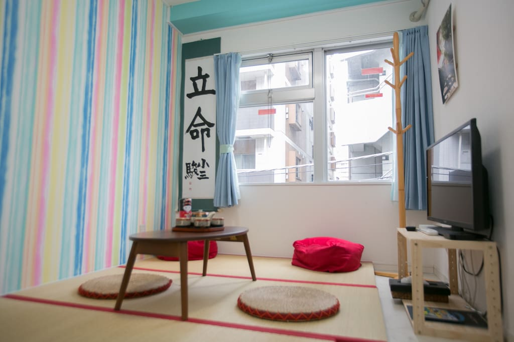 futon packed away, showing the tatami and TV - bedroom 3/living room