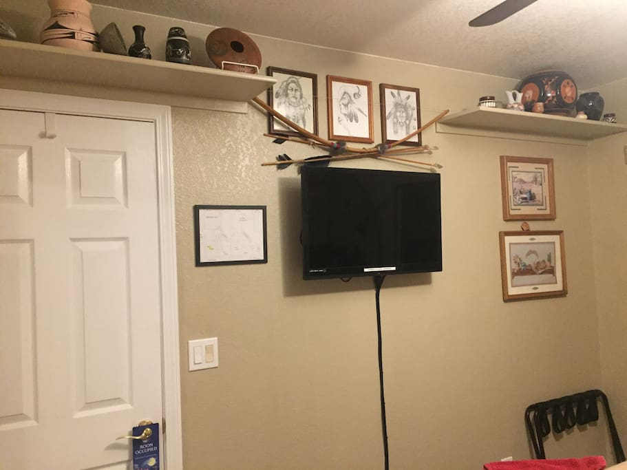West room flat screen , Native pottery, hand drawn art and bow and arrow.