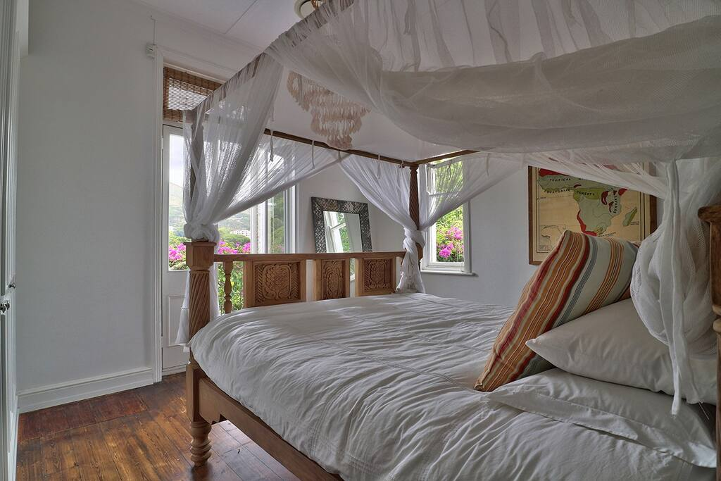Four poster bed in main bedroom with views of Lions head opens up to balcony