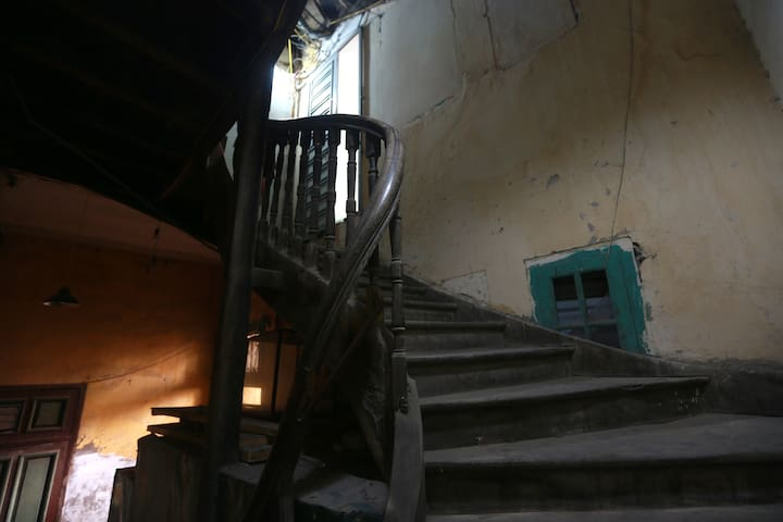 Wood staircase lead to B-home that very popular in French colonial building