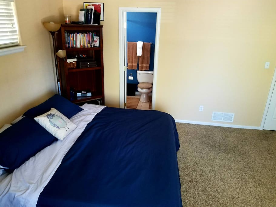 King-sized memory foam bed, along with the master bathroom  doorway.