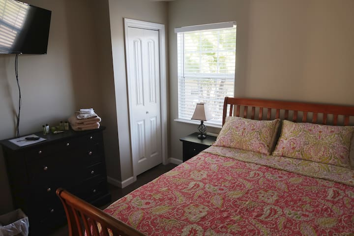 Private Queen bedroom in a shared space.