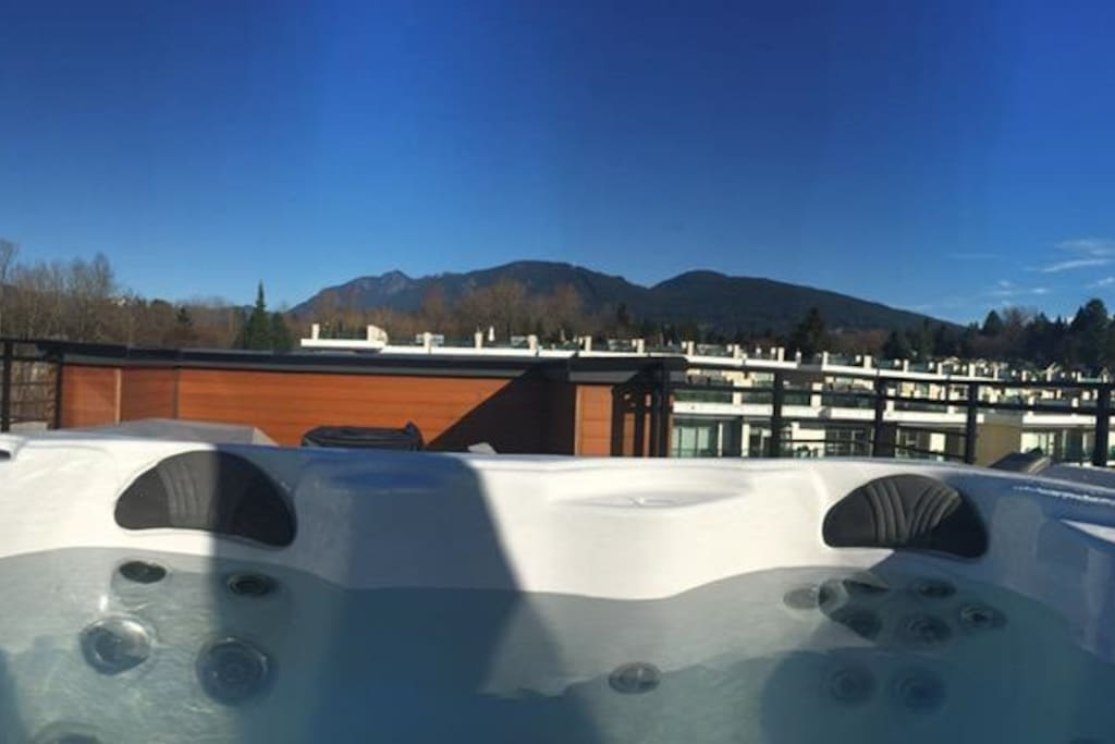 Private Hot Tub with a stunning view of the mountains on a 650 square foot roof top deck!!