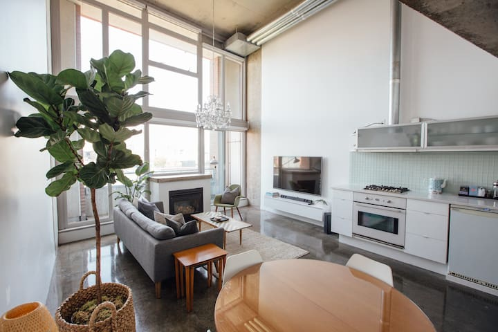 East facing two level loft with 16ft floor to ceiling windows (equip with white opaque black-out blinds) and a small balcony.