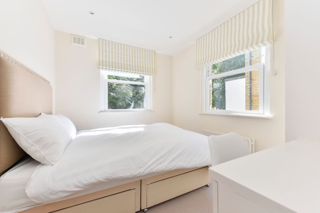 Bedroom 1 has two large windows, comfy double bed, ensuite bathroom and dressing table.