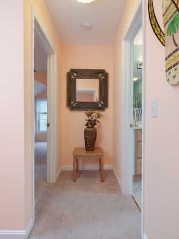 Mirror Mirror on the Wall...Golf Anyone? Don't forget your tee time. Blue Heron Public Golf Course is across the street. Entrance is off of main road. A hallway separates the 2 Queen upstairs bedrooms and full bath.