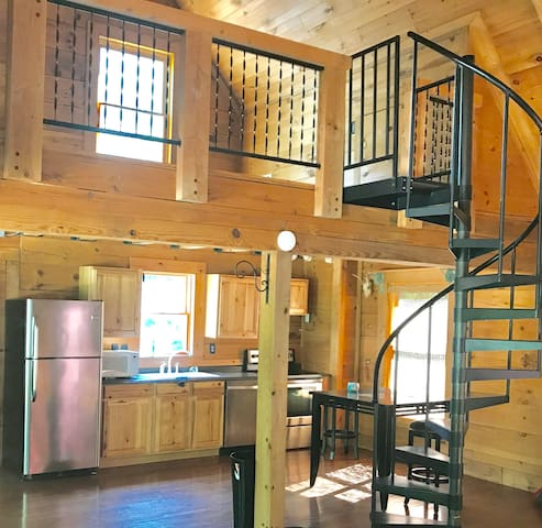 Spiral staircase up to the bedroom loft
