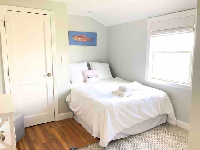 Bedroom 2 - full bed w views of pond and peeks of the ocean.