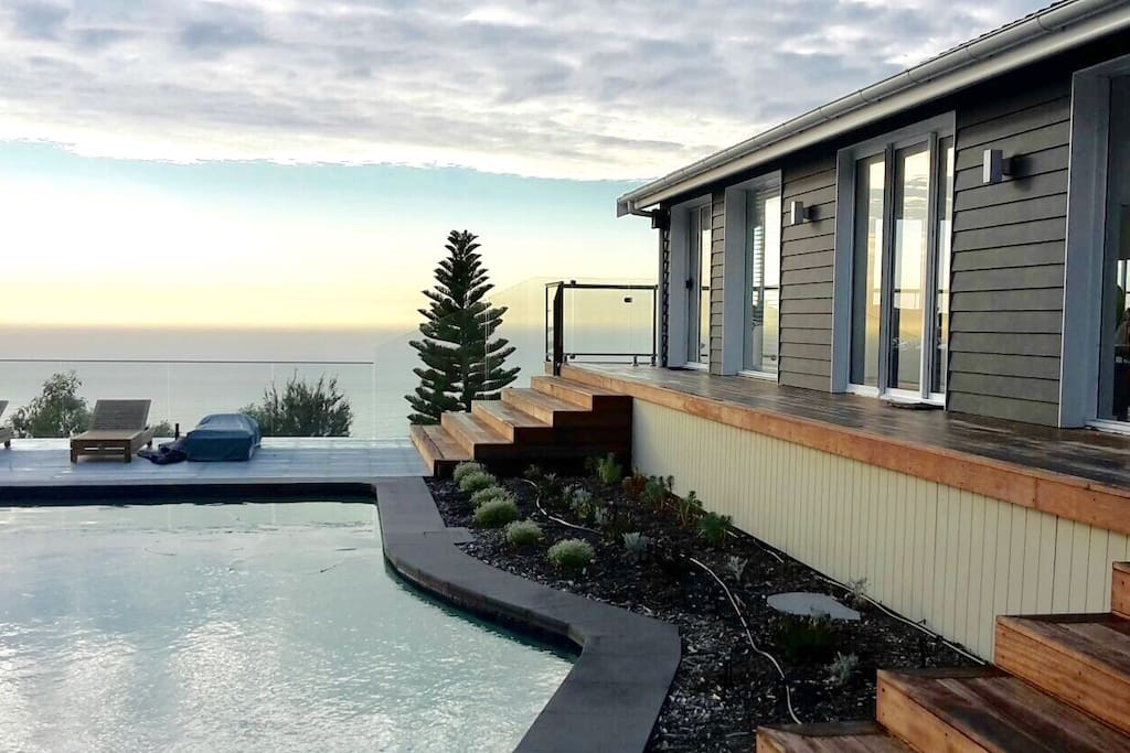 Views to the ocean and back to house from the pool deck