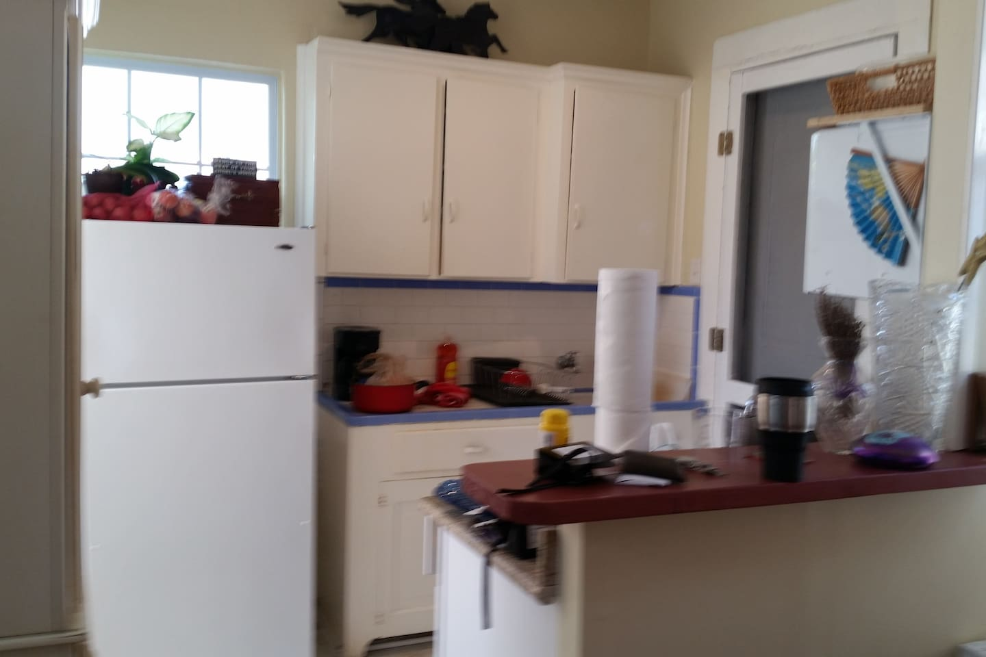 Compact Kitchen with door to the porch.